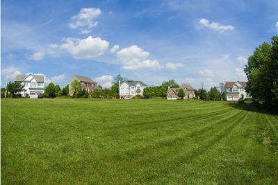 Suburban houses in a field