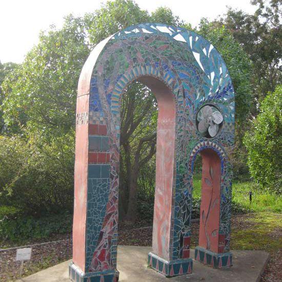 A sculpture in a community garden.