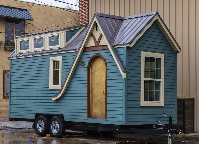 Blue tiny house on a trailer