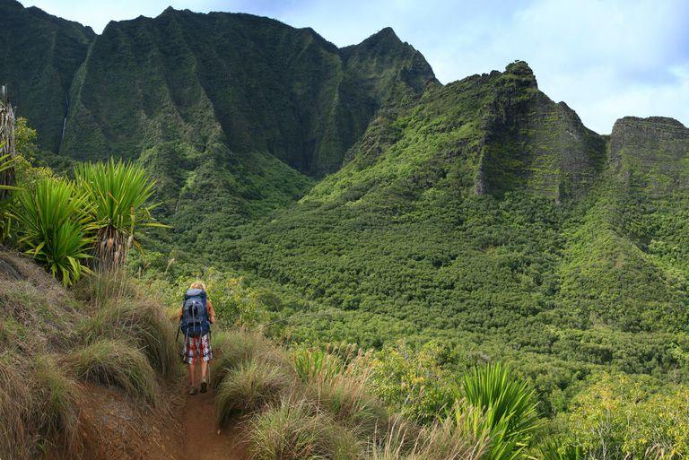 Backpacker on Kalalau Trail, Na Pali coastline, Hawaii
