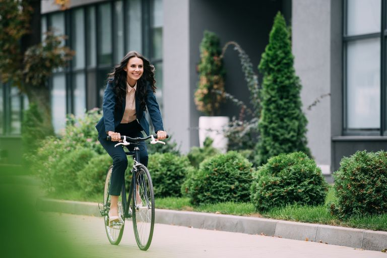 smiling woman riding a bicycle