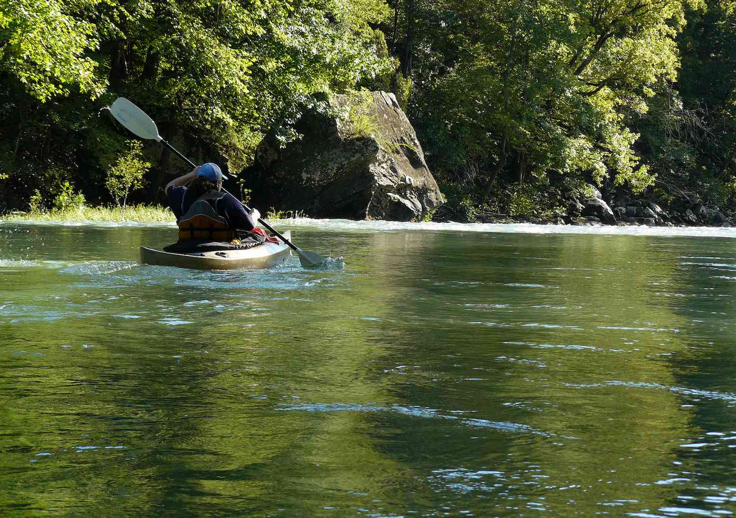 A canoeist paddles down the Mulberry River in Arkansas