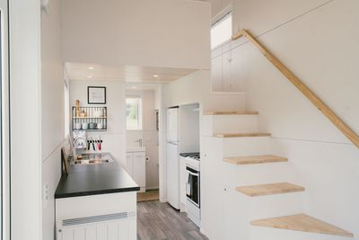The Archer Tiny House kitchen and stairs