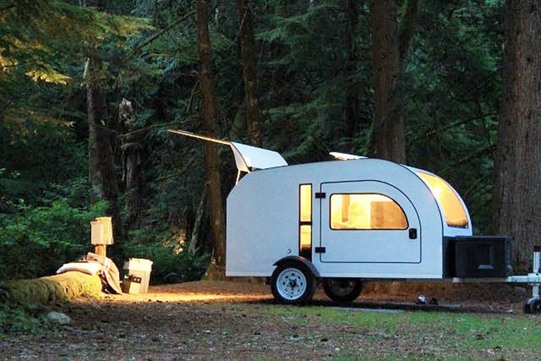 Tiny camper parked in the woods