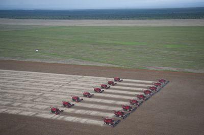 Combines to harvest soybeans sit at the Morro Azul farm about 70km from Tangara da Serra , Mato Grosso, Brazi