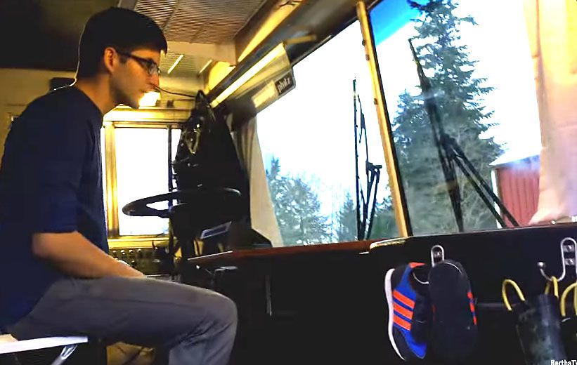 Man sitting in the driver's seat of a bus