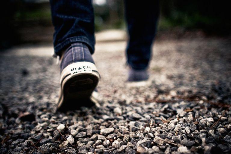 Sneakers walking on gravel path