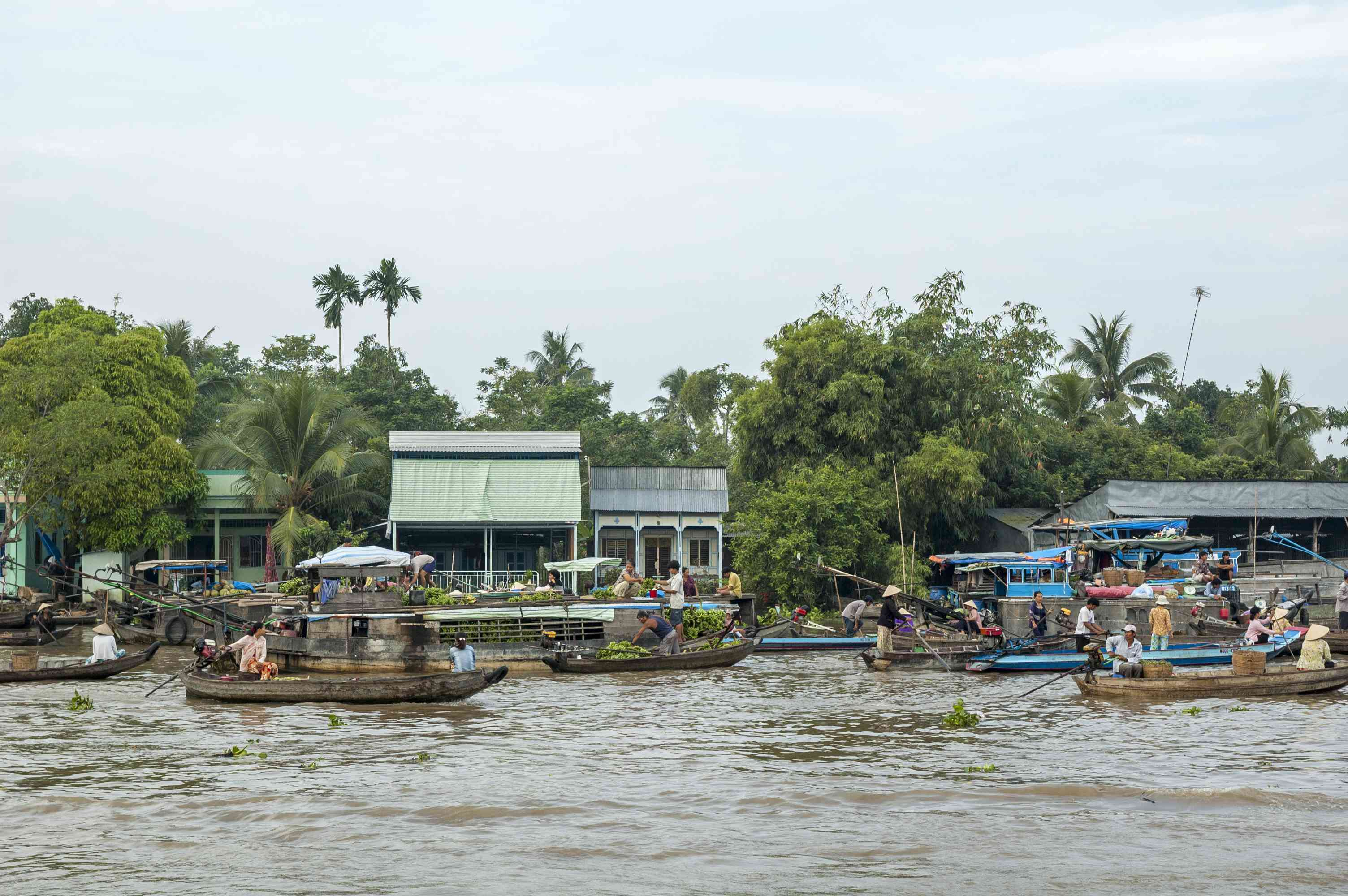 floating market on busy canal in Can Tho, Vietnam