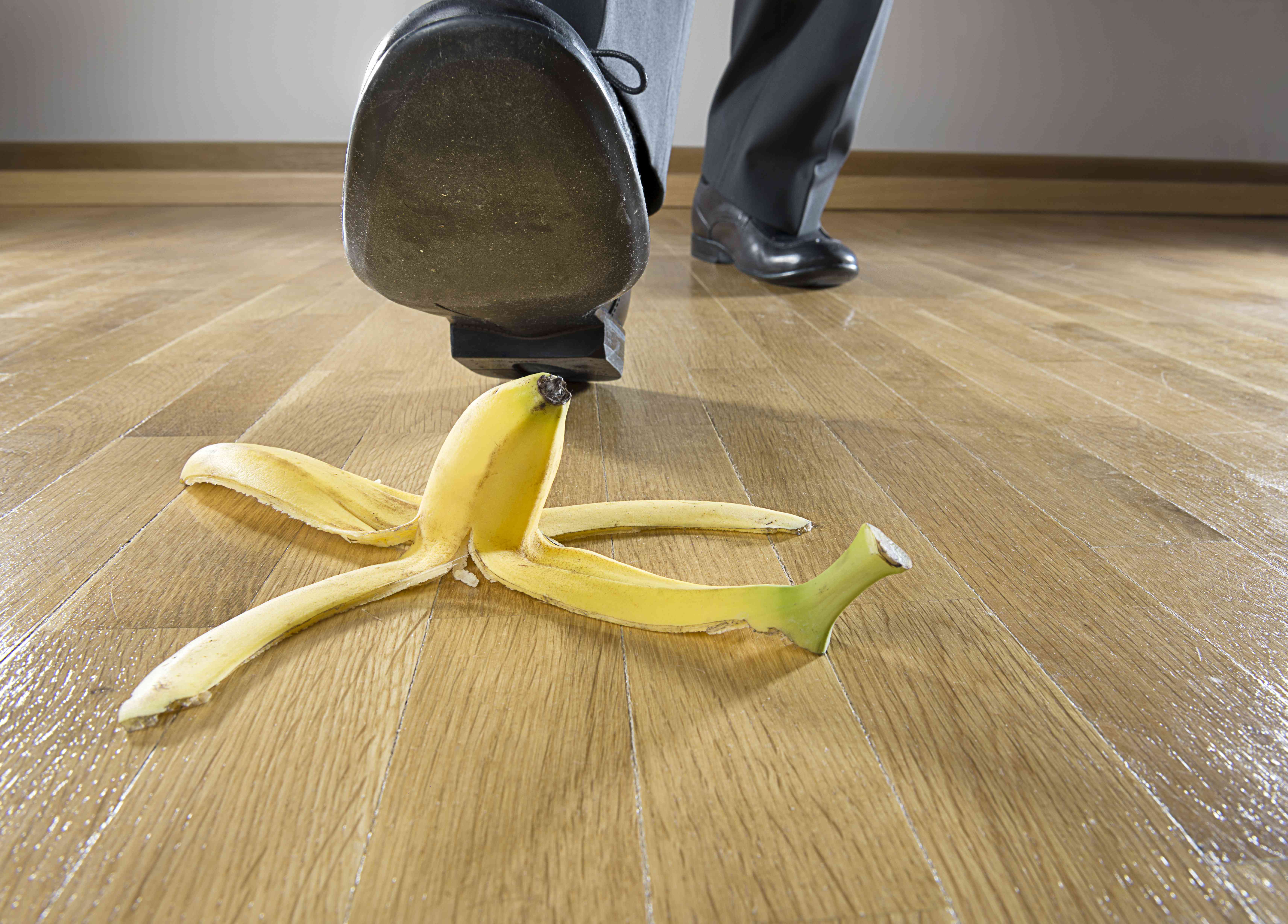 A man about to step on a banana peel.
