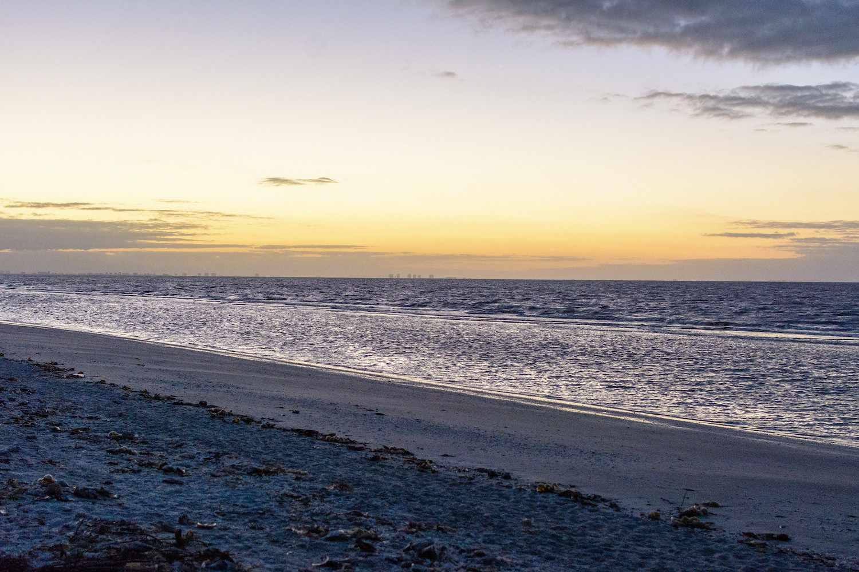 A beach at Sanibel Island during sunset