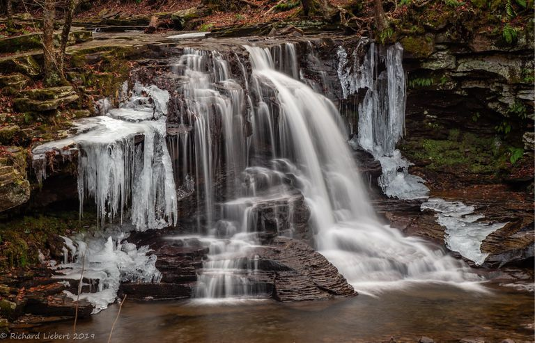 Large waterfall pouring over rocks
