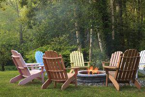 Adirondack chairs around the fire