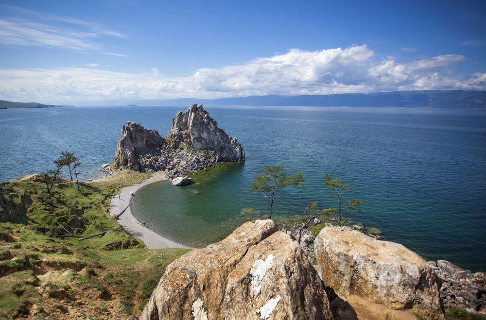 A rocky promontory juts out into a blue lake