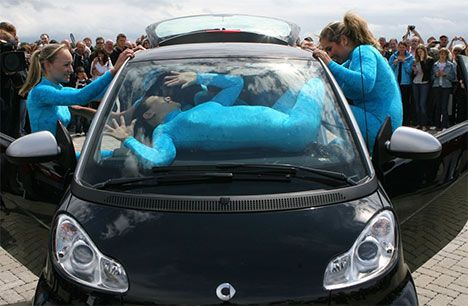 Smart Car with 13 people inside photo