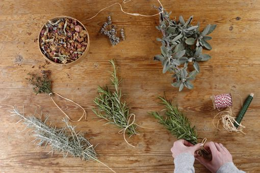 Herbs are being bundled to dry