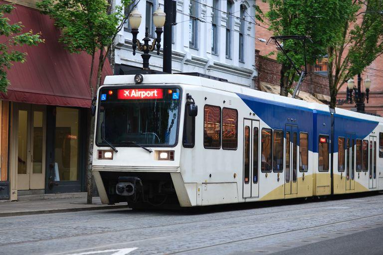 A Portland streetcar moving on an urban street.
