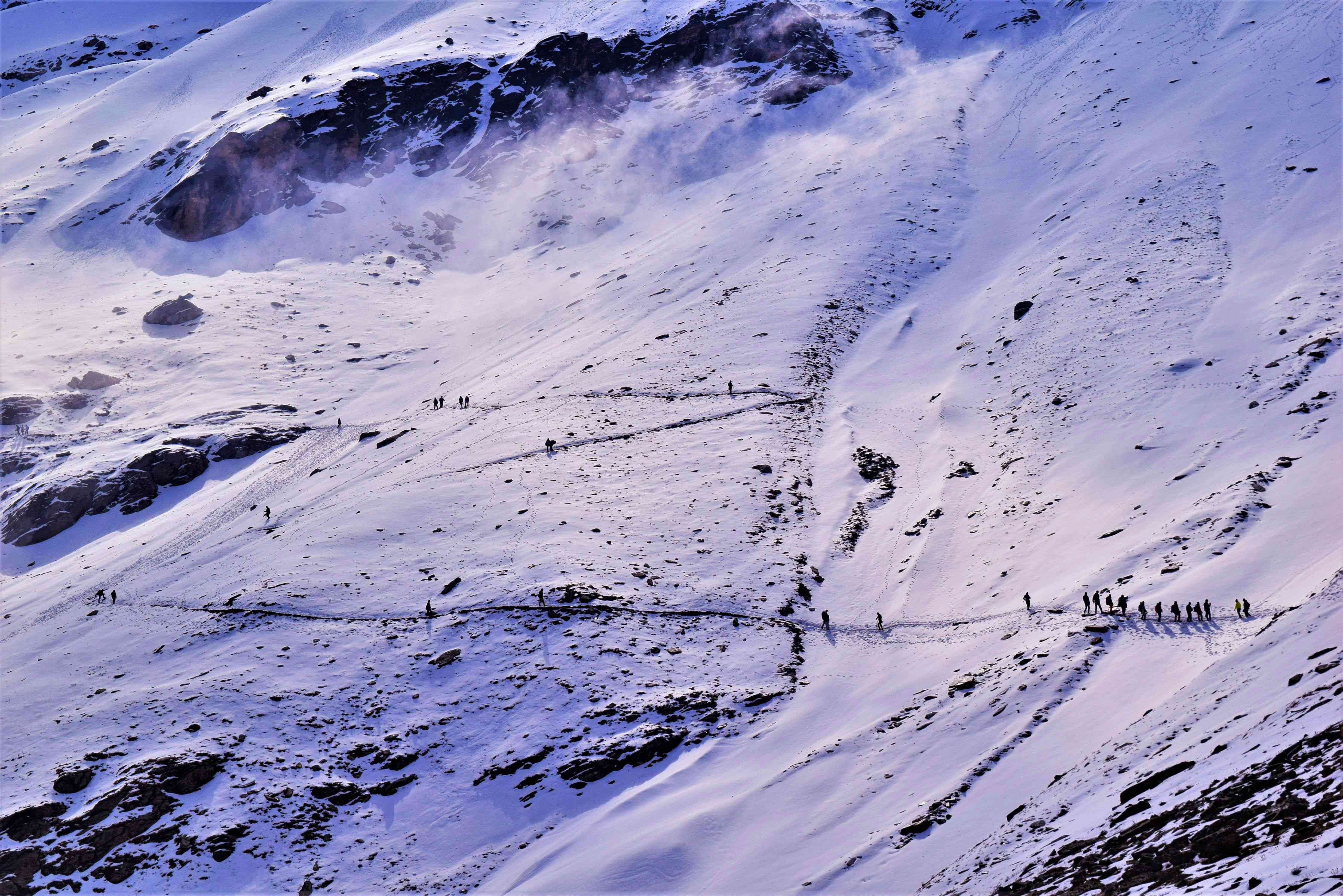 A view of hikers making their way around Roopkund, the skeleton lake