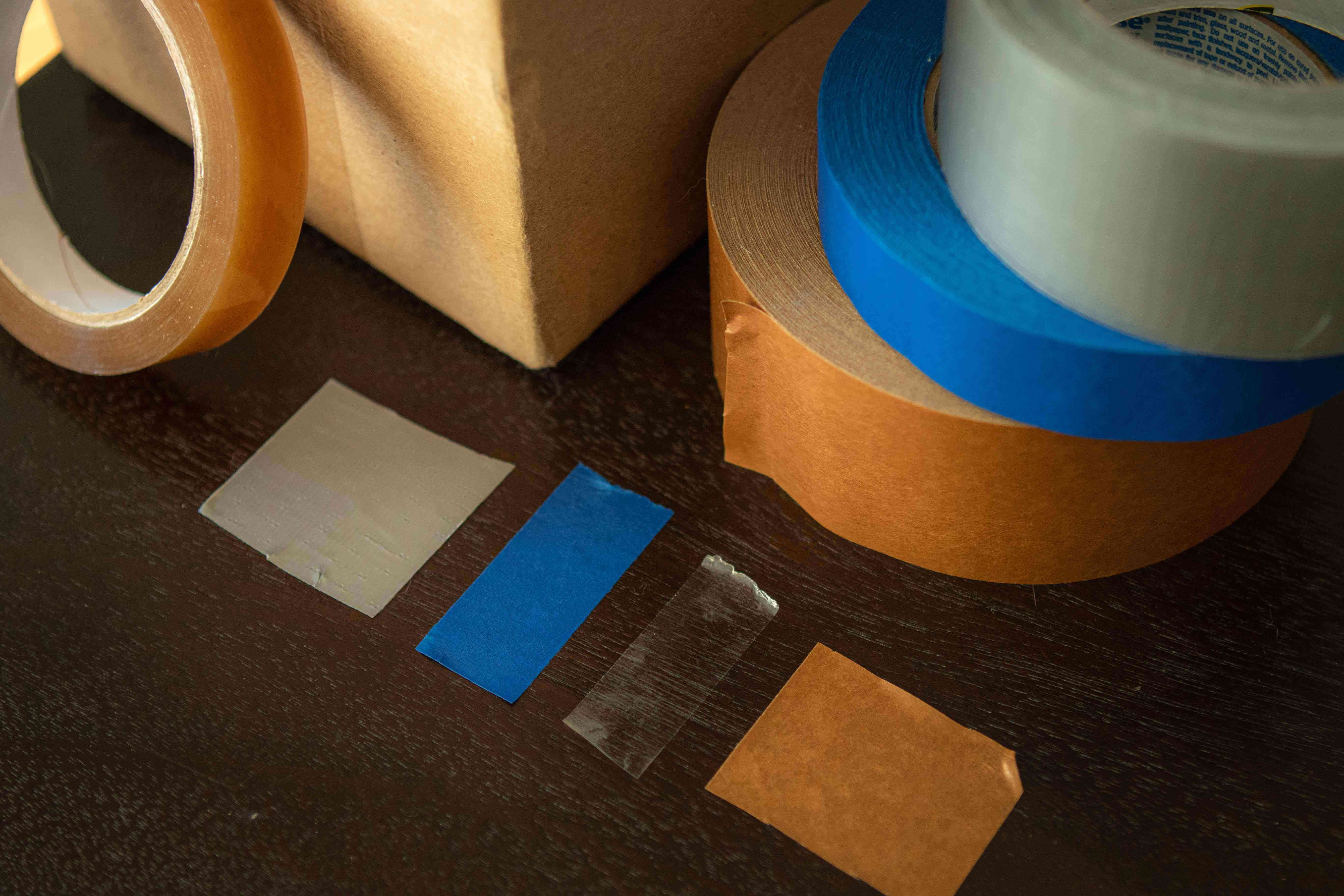 various types of tape with gray duct tape on top