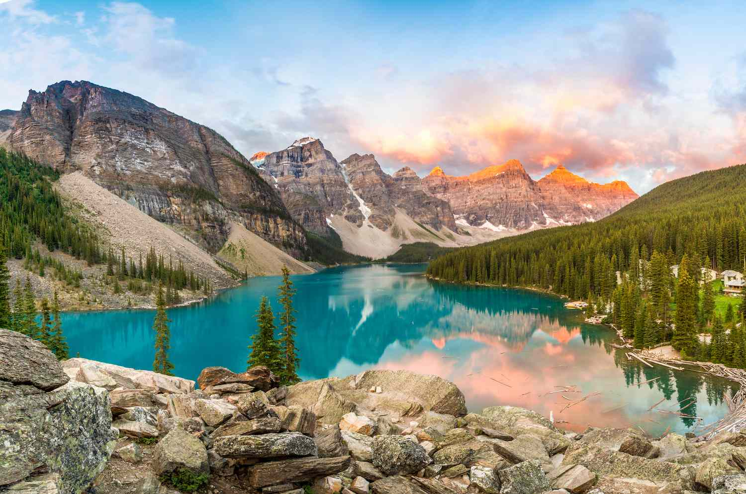 The sun rises above the mountains at Banff National Park