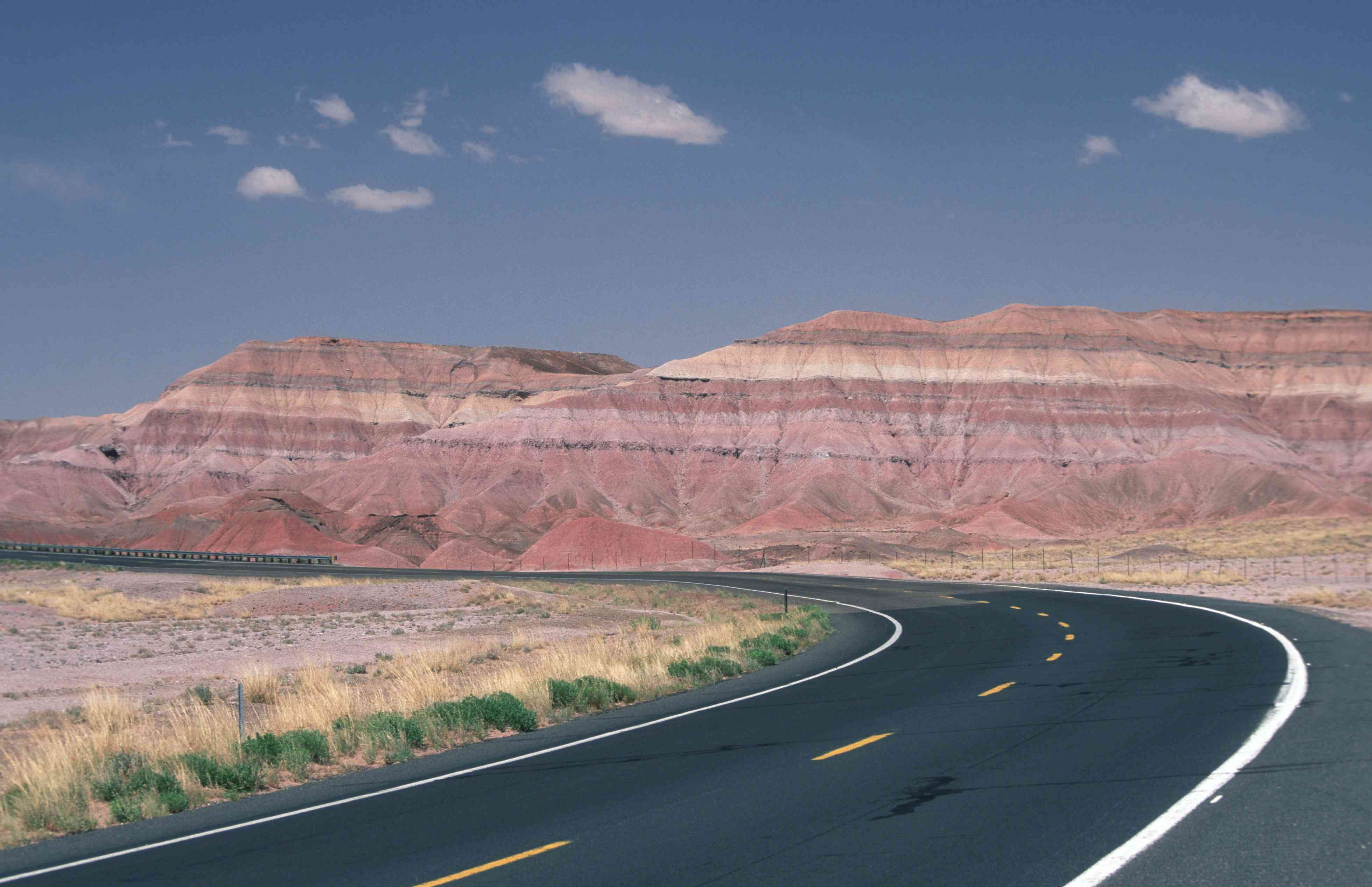 Red rock formations on the side of Route 160