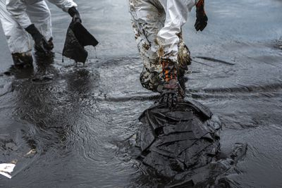 People Walking In Water and oil