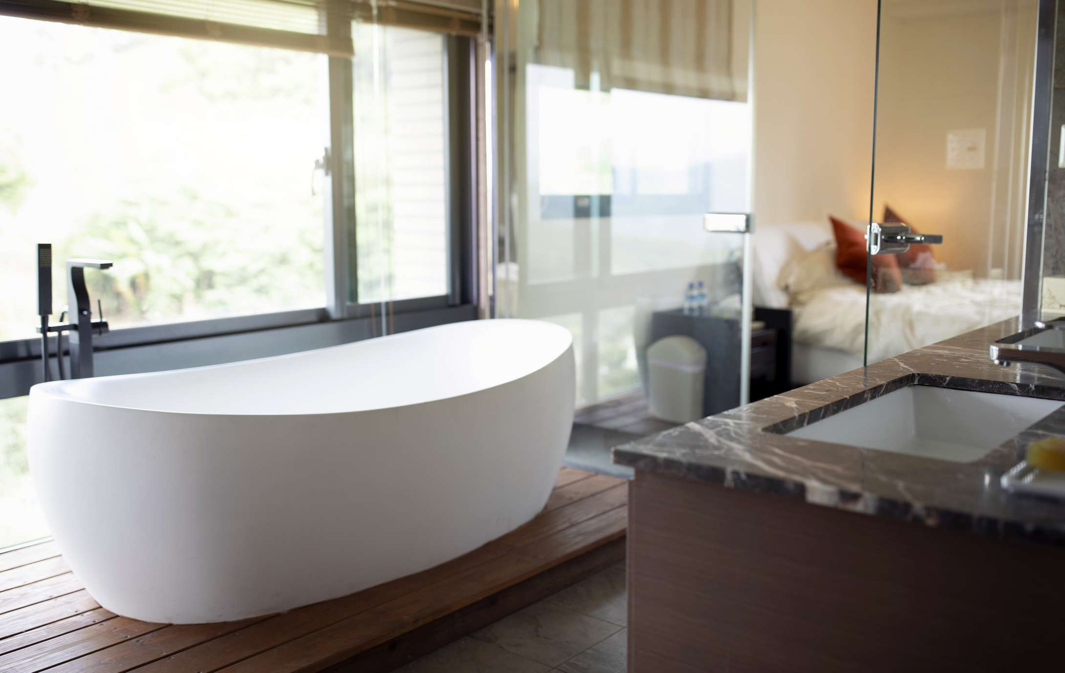 Bathroom fixtures and glass partitions may be cleaner longer because of PFAS
