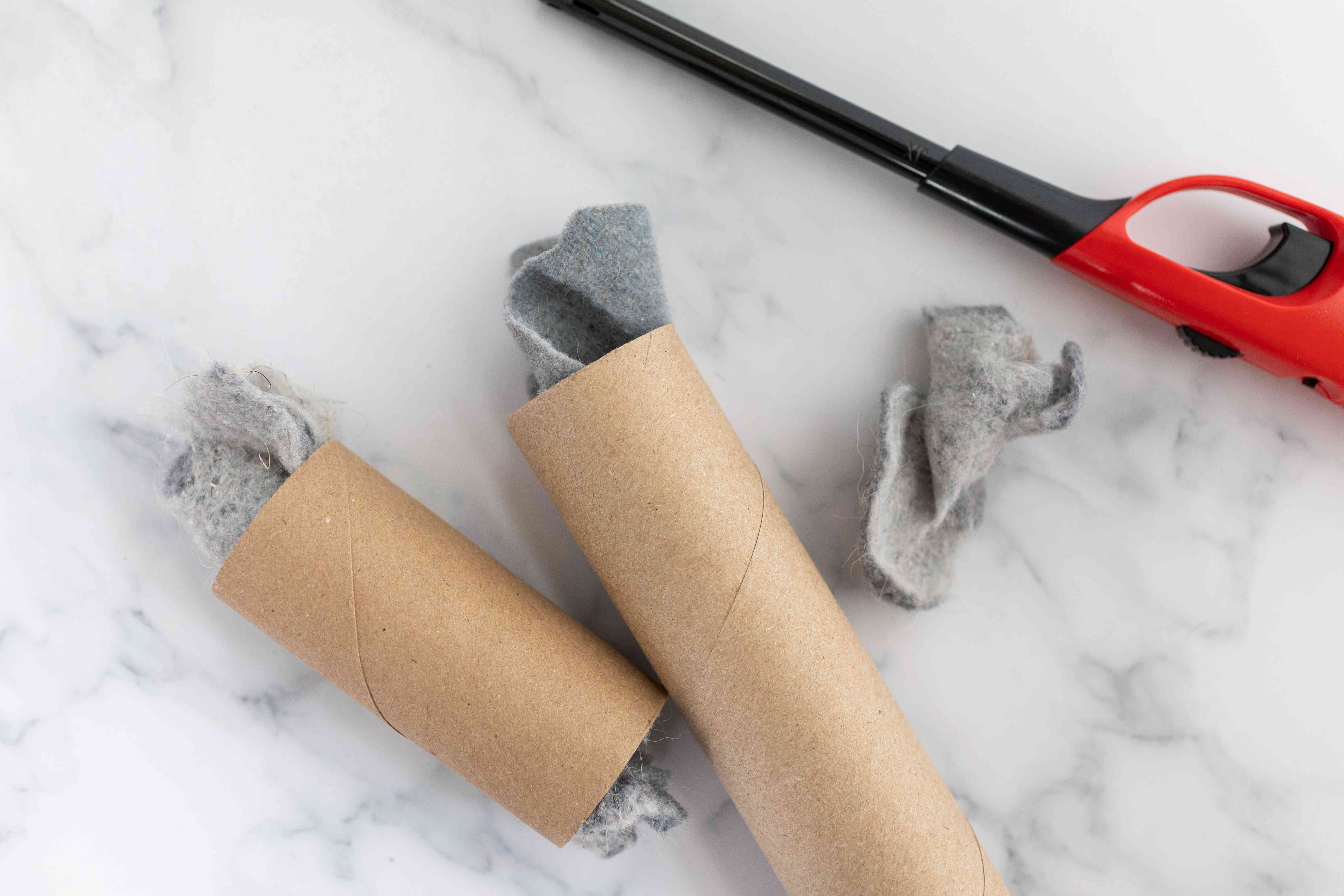 used toilet paper rolls are stuffed with dryer lint as a fire starter with lighter