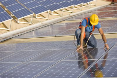 Image of a worker supervising a photovoltaic installation