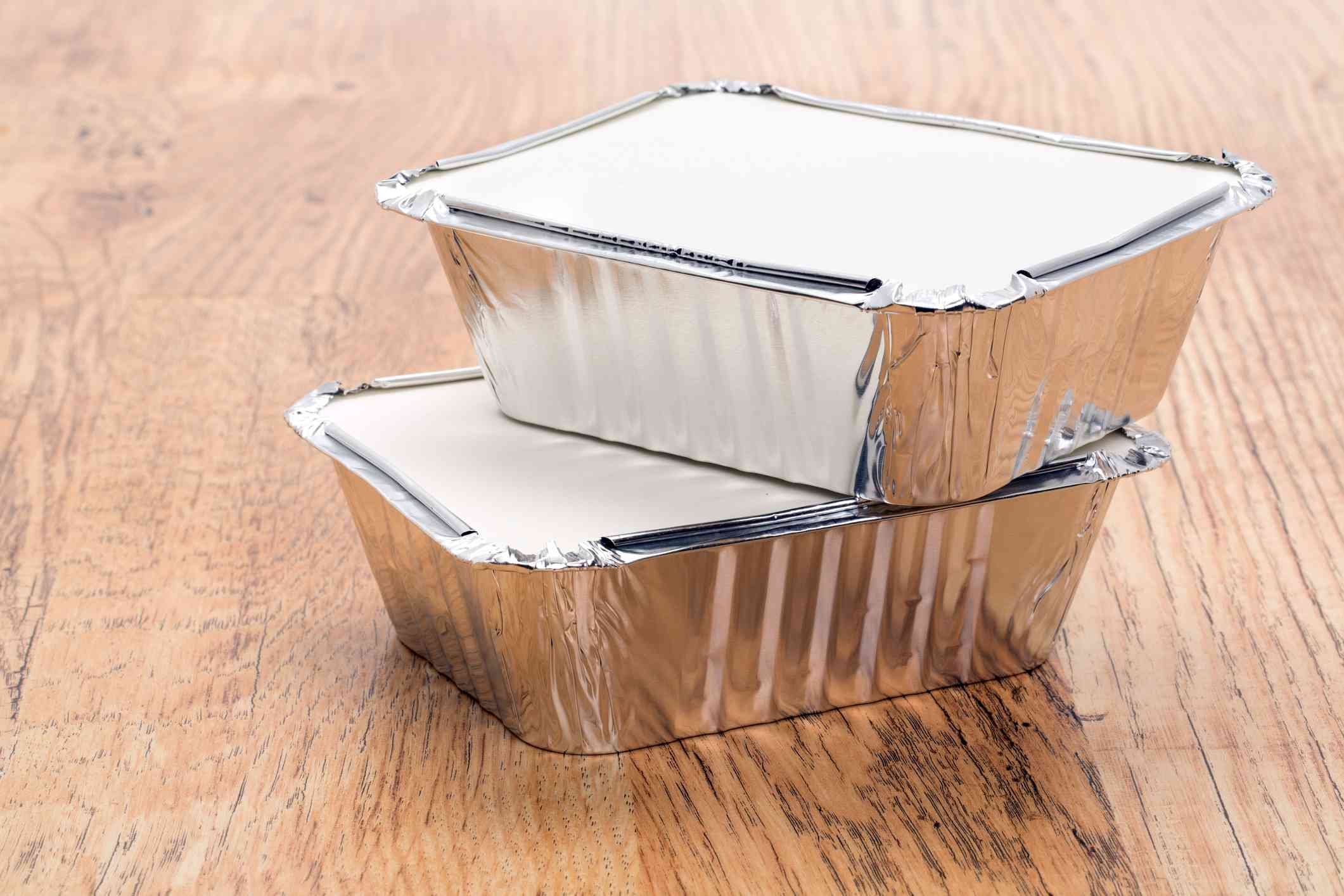 Two stacked aluminum food containers.