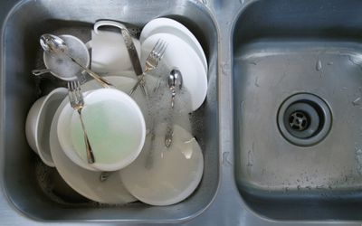 image of a double Sink Full of Dirty Dishes -