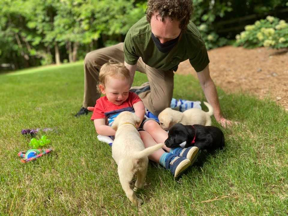 Russell and Henry McLendon with puppies
