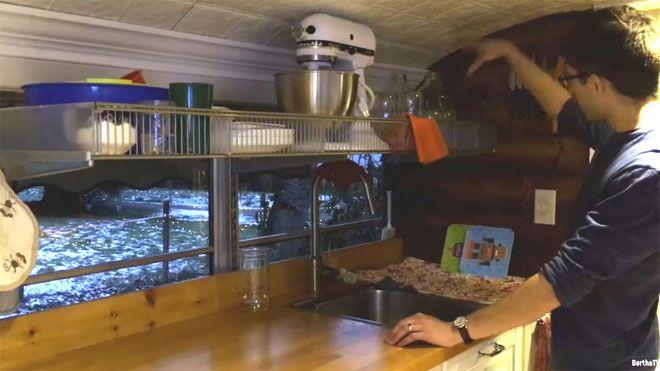 An appliance rack above a kitchen sink