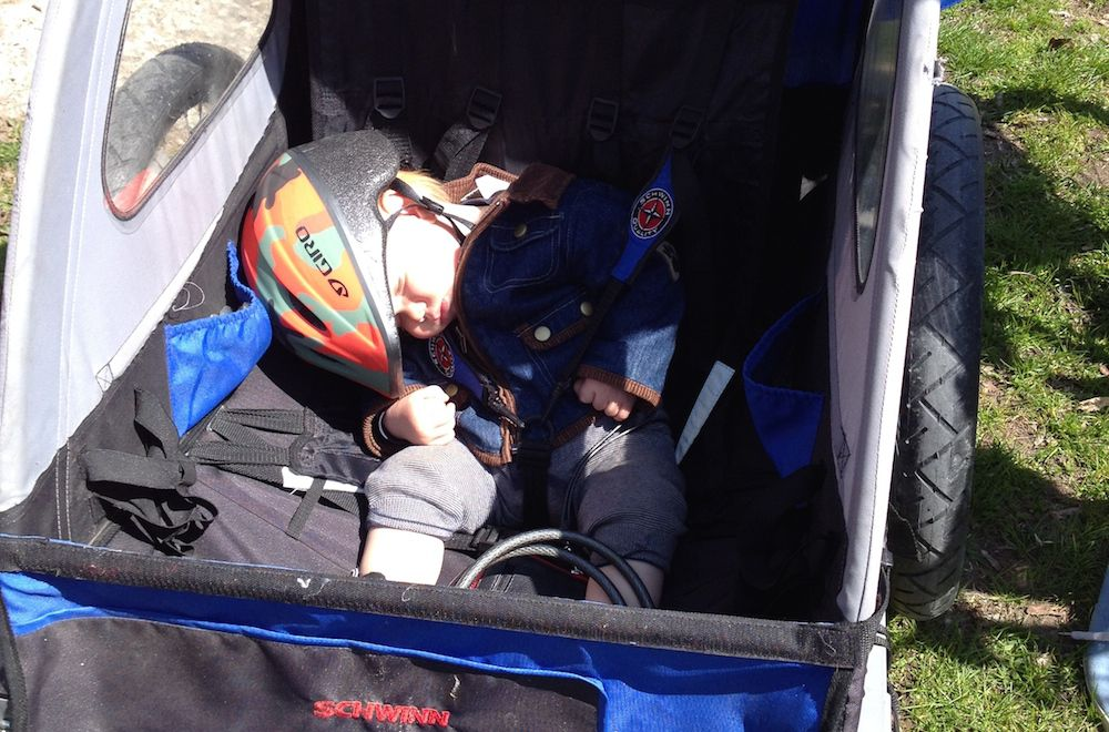 sleeping baby in bike trailer