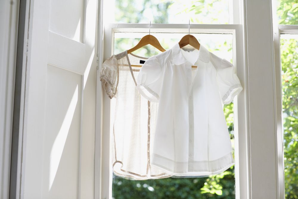 white clothes drying by an open window