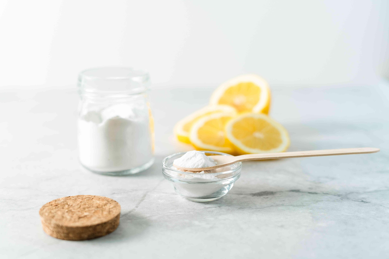 Jar of baking soda with cut lemon slices