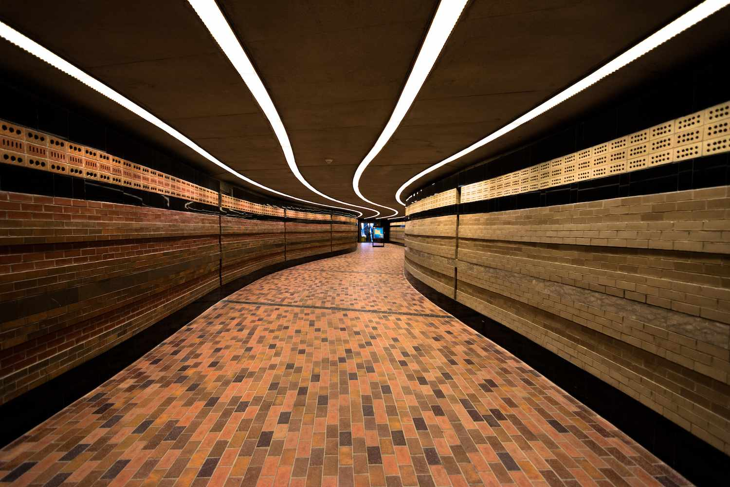 A modern tunnel connects segments of Underground City in Montreal