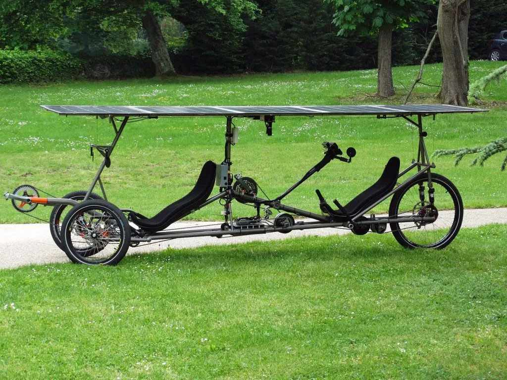 Tandem bike with solar panel roof