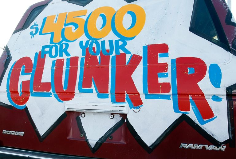 A Clash for Clunker deal painted on a Dodge Ram van.