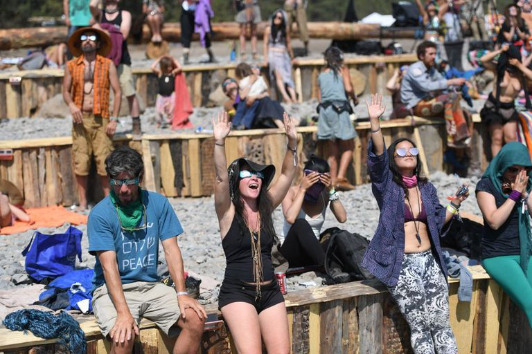 Young people gather to watch the solar eclipse