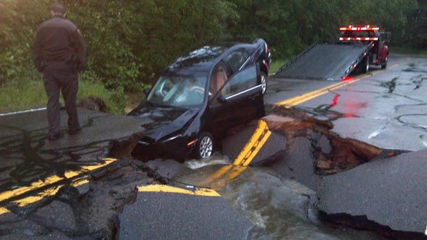 Car in hole after Duluth flooding