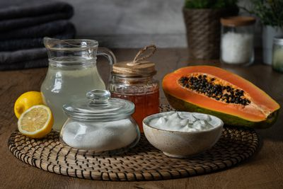exfoliate naturally with papaya, sugar, yogurt, lemons, and honey on mat