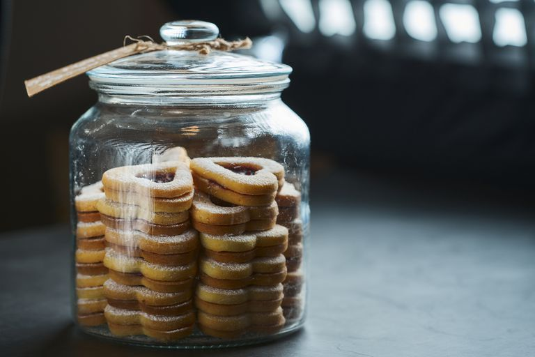 A glass full of Christmas heart-shaped shortbread biscuits