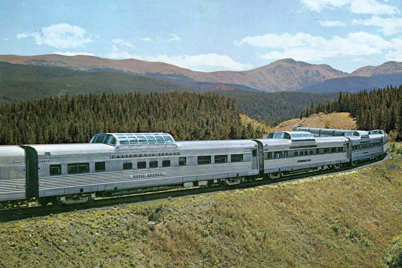 California Zephyr train with Colorado Rocky Mountains in background