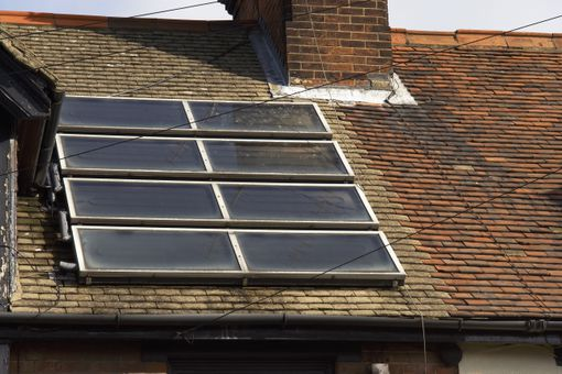 Residential property with solar panels in the roof.