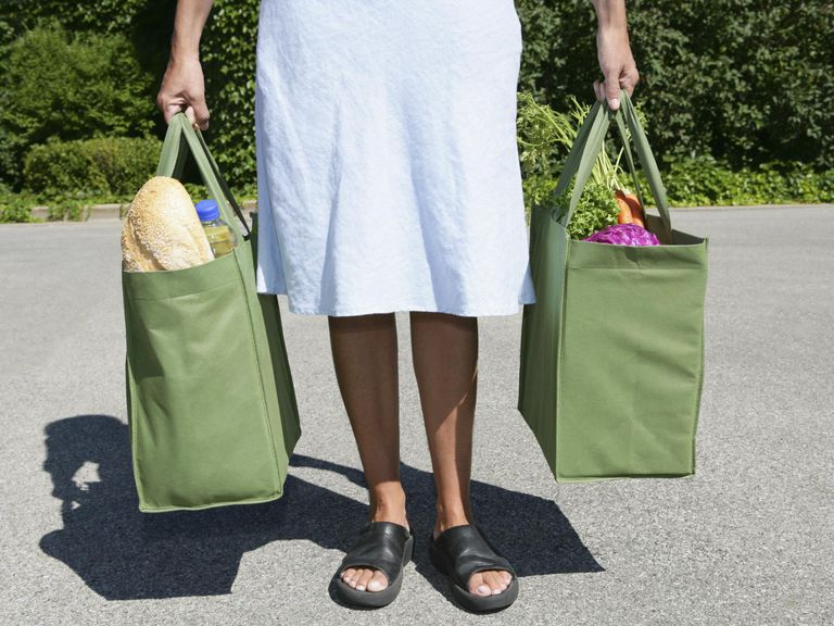 Woman with reusable grocery bags