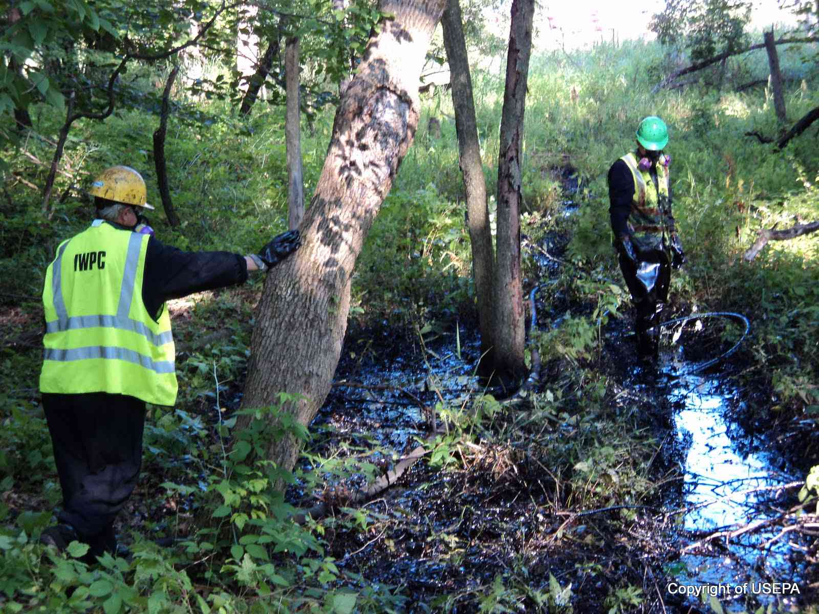 Vacuum crews work to remove oil near spill site