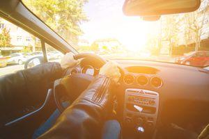 Man driving hybrid car