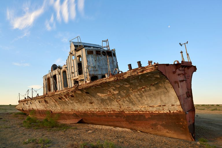 Rusted abandoned ship sitting in the sand in the former Aral Sea