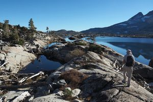 Hiker on the Tahoe Rim Trail next to Aloha Lake