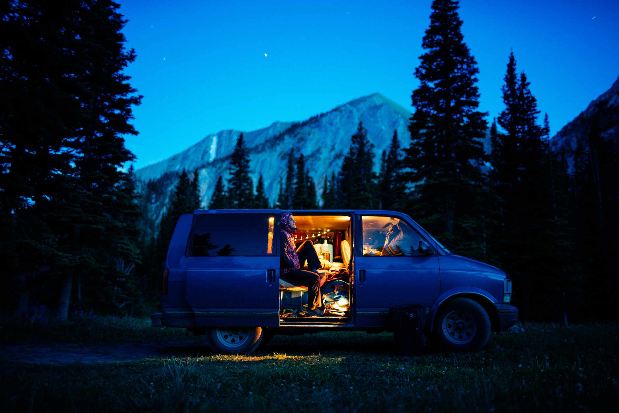 Van camping with mountain view at dusk